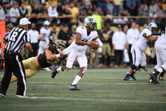 Western Michigan University senior defensive end Tony Balabani (58) sacks Monmouth quarterback Kenji Bahar on Saturday, Sept. 14, 2019 in Kalamazoo, Mich.