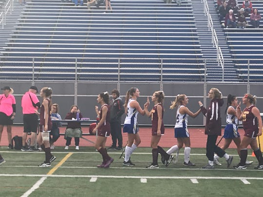 Players from host Maine-Endwell and Whitney Point shake hands following Tuesday's Section 4 Conference Division I field hockey game. The Spartans won, 5-0.