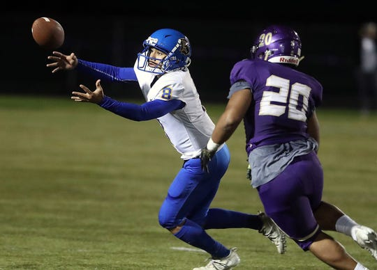 Bremerton quarterback Kelo Legova (left) and the Knights host North Kitsap on Friday. Bremerton is looking for its first win against the Vikings since 2012.