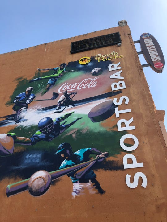Coca-Cola partnered with six downtown businesses recently, upgrading signs with the beverage-company's logo and other advertising.