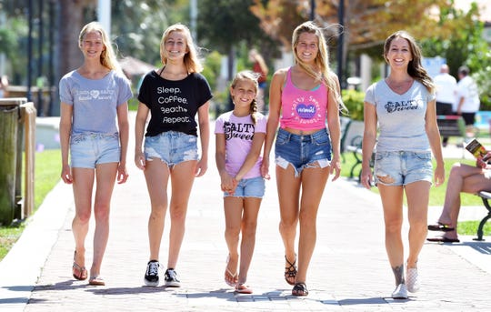 Left to right, Sarah Stotz, Kialani McCutchan, Grier Hensley, Makaya McCutchan, and Crystal Cooper, owner and founder of Salty Sweet, posing in Cocoa Village wearing Salty Sweet shirts, which help fund the annual Salty Sweet & Barefoot Designs Pro/Am Surf Contest in Cocoa Beach, October 5th. The clothing is available at Barefoot Designs in Cocoa Village, owned by Barbara Bumgardner, a host sponsor of the event.