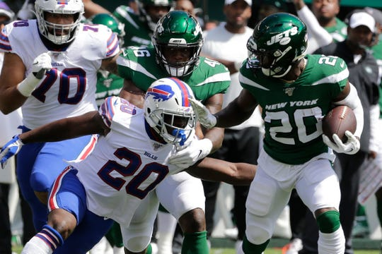 Buffalo's Frank Gore (20) attempts to tackle New York Jets defender Marcus Maye (20) after the Holy Trinity standout got his hands on a pass during the first half of a game Sunday, Sept. 8, 2019, in East Rutherford, N.J.