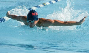 Grayson Goodwin of Cocoa Beach competes in the 100 butterfly during Tuesday's meet with Titusville.