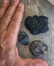 Mitch Roffer, of Melbourne Beach, found these bits of tar this week near his home, and similar tar on Playalinda Beach in Canaveral National Seashore.