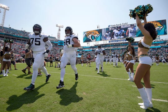 Jacksonville Jaguars offensive tackle Jawaan Taylor (75) of Cocoa, and offensive guard Andrew Norwell (68) run onto the field during player introductions before a game against the Kansas City Chiefs on Sunday, Sept. 8, 2019, in Jacksonville.