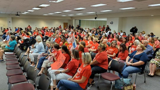 In a scene reminiscent of last year's demonstrations, more than 70 teachers showed up at Tuesday's school board meeting to vent their frustrations at ongoing pay talks.