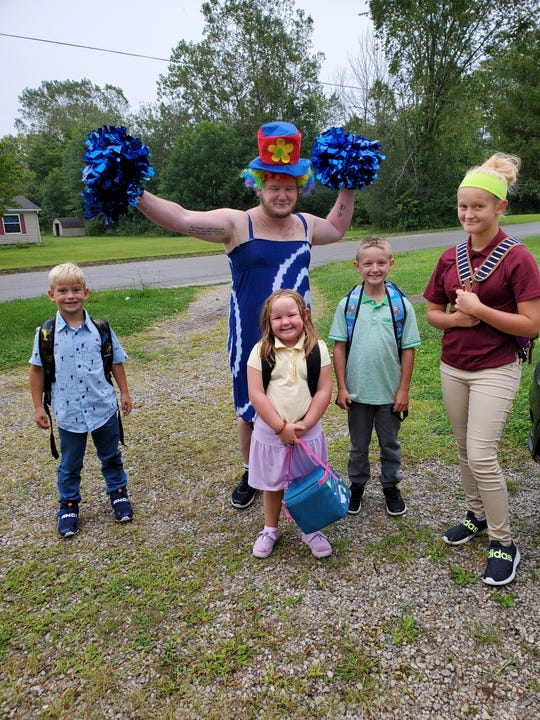 B Lavene meets the school bus in front of his Crestline home every Monday afternoon wearing a different silly outfit. A video of the greetings has gone viral online, with more than 8 million views.