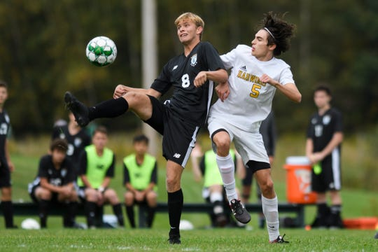 Stowe's Max Gentle (8) battles for the ball with Harwood's Jasper Koliba (5) during the boys soccer game between the Harwood Highlanders and the Stowe Raiders at Stowe High School on Tuesday afternoon September 24, 2019 in Stowe, Vermont.