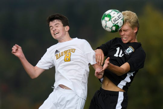 Stowe's Jackson Seivwright (10) heads the ball over Harwood's Cole Hill (8) during the boys soccer game between the Harwood Highlanders and the Stowe Raiders at Stowe High School on Tuesday afternoon September 24, 2019 in Stowe, Vermont.