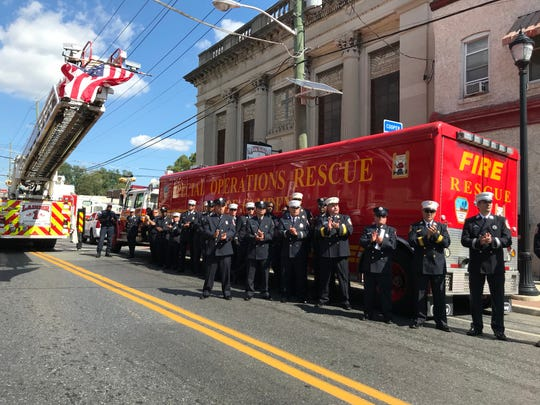 Camden firefighters in applaud their department's 150th anniversary during a ceremony Wednesday along South Broadway.