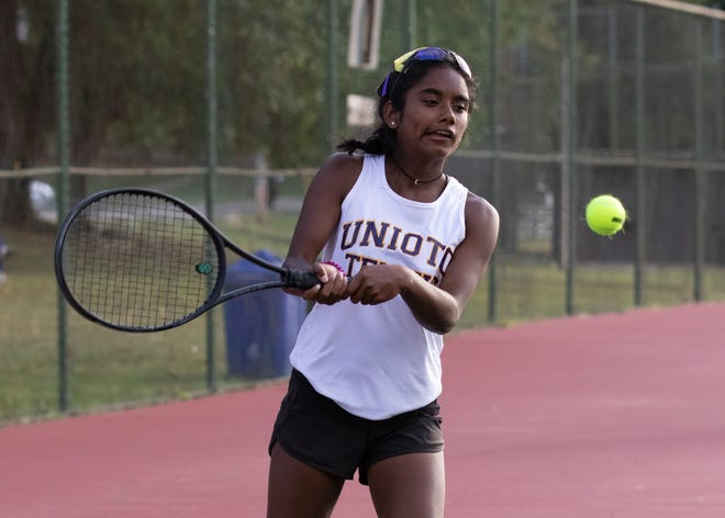 Unioto's Sylvia Gray hits the ball during a 4-1 win over Portsmouth at Yoctangee Park in Chillicothe, Ohio.