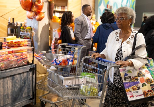 Kay Turnage of Clifton shops at Kroger's new Downtown store at the corner of Court and Walnut streets Wednesday, September 25, 2019. Turnage said always attends the openings of new Kroger stores and that she arrived at 6 a.m. for Wednesday's opening.