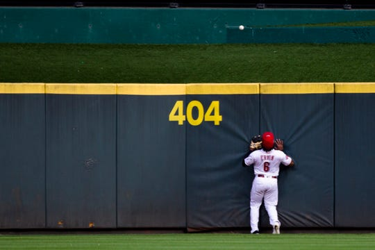 Cincinnati Reds right fielder Phillip Ervin (6) looks on as Milwaukee Brewers first baseman Eric Thames (7) ball sales out over center in the first inning of the MLB game between Cincinnati Reds and Milwaukee Brewers at Great American Ball Park in Cincinnati on Wednesday, Sept. 25, 2019.