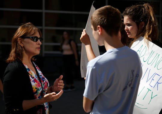 Cynthia Ris, an English instructor and chair of the faculty senate, talks with supporters outside of the Tangeman University Center on the University of Cincinnati campus in the University Heights neighborhood of Cincinnati on Wednesday, Sept. 25, 2019.