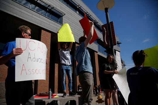 Supporters gather outside of the Tangeman University Center on the University of Cincinnati campus in the University Heights neighborhood of Cincinnati on Wednesday, Sept. 25, 2019. A small protest gathered in support of adjunct professors and the UC Adjunct Advocacy Association.