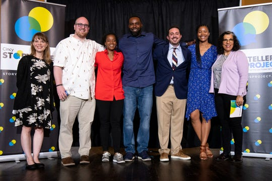 Enquirer staff members Melanie Laughman, left, and Anne Saker, right, host the Cincinnati Storytellers Project with Andy Clark, Kim Corbitt, Antwan Peek, Patrick Brennan and Nia Baucke telling their stories of champions and underdogs Sept. 24, 2019 at the Transept in Over-the-Rhine.
