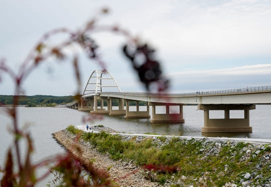 The new bridge can be seen under hanging berries after the ribbon cutting ceremony for a multi-use trail and honorary opening of the new bridge across the Cumberland River at Lake Barkley Bridge in Canton, KY., on Wednesday, Sept. 25, 2019.