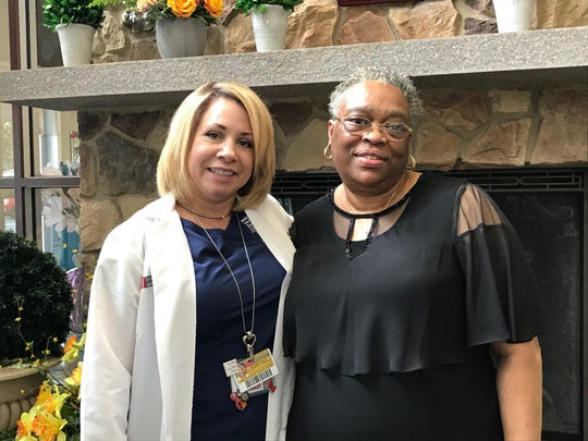 A registered nurse for 32 years, Kimberly Cromwell-Piniella (left) serves as the Breast CancerPatient Navigator at the Steeplechase Cancer Center at Robert Wood Johnson University Hospital Somerset in Somerville. For the past five years, Cromwell-Piniella has been aliteral GPS for men and women diagnosedwith breast cancer, such as Kressie Smith (right) of Somerset, as they wind their way through daily life — a myriad of appointments, treatments, therapies, surgeries andemotions.