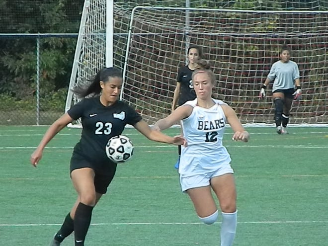 Old Bridge's Ava Morales (23) and East Brunswick's Madison Mandleur vie for the ball on Tuesday, Sept. 24, 2019.