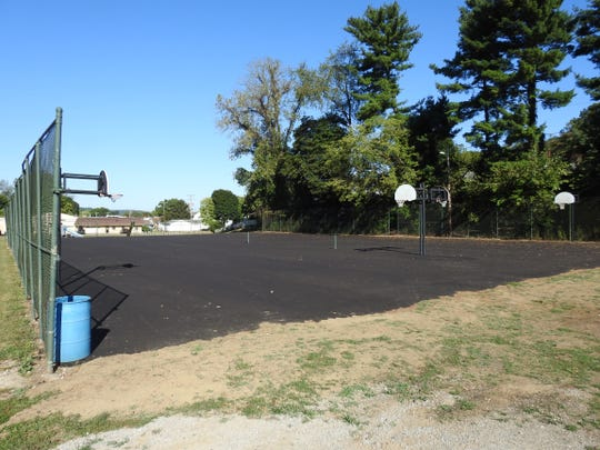 Recent work at Hall Park includes paving of courts and construction of a walking path. Professional striping with posts and nets are set for the basketball courts, one tennis court and three new pickleball courts.