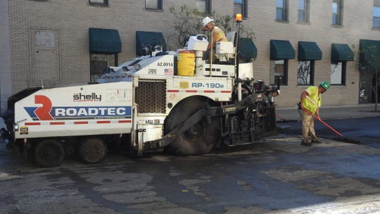 Shelly Co. crews worked on milling and paving near the intersection of Fourth and Main streets earlier this week.