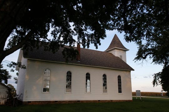 The setting sun paints the western side of the Palmyra Church on Sept. 24. Efforts are being made to raise money to maintain the historic Palmyra Church. In 2016 a new roof was put on the structure, which dates to 1870, but more work is needed.