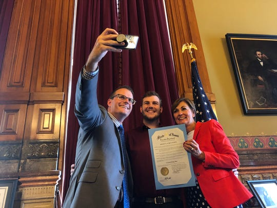 Carson King poses for a selfie with Lieutenant Governor Adam Gregg and Governor Kim Reynolds after Reynolds signed a proclamation making Sep. 28 Carson King Day in Iowa to honor of his efforts to raise money for the University of Iowa Stead Family Children's Hospital on Wednesday, Sep. 25, 2019, at the Iowa State Capitol.