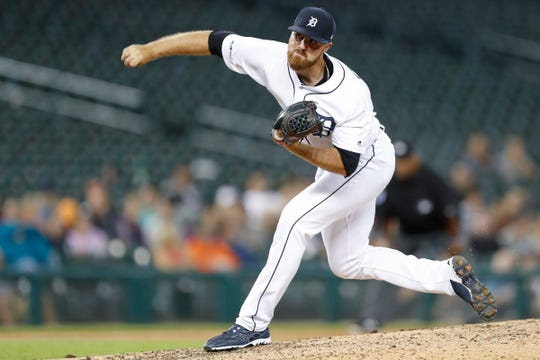 Detroit Tigers relief pitcher Buck Farmer (45) follows through on a pitch during the ninth inning against the Minnesota Twins at Comerica Park on Tuesday, Sept. 24, 2019.