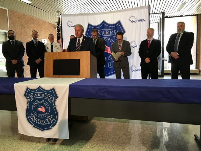 Warren Police Commissioner Bill Dwyer, center, discusses how Warren Police, Detroit Police and federal agencies dismantled a drug organization based in Detroit that authorities believe to be supplying drugs to Detroit and Oakland and Macomb counties during a news conference Sept. 25, 2019 inside Warren Police Headquarters