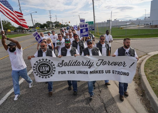UAW Local 598 members march along Van Slyke Road in Flint on Tuesday, September 24, 2019 on their way to the south gate. They were commemorating the 50th anniversary of the 1969 strike by Local 598 Fisher Body workers. It was the longest strike in General Motors' history, lasting 136 days.