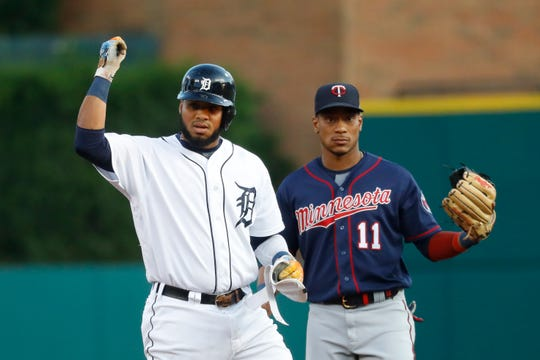 Detroit Tigers' Dawel Lugo reacts to his double, next to Minnesota Twins shortstop Jorge Polanco during the first inning of a baseball game in Detroit, Tuesday, Sept. 24, 2019.
