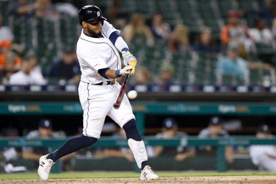 Detroit Tigers third baseman Dawel Lugo (18) hits a RBI double during the eighth inning against the Minnesota Twins at Comerica Park on Tuesday, Sept. 24, 2019.