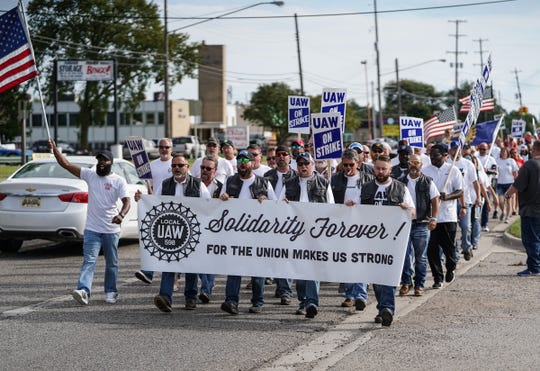 UAW Local 598 members march along Van Slyke Rd. In Flint on Tuesday, September 24, 2019 on their way to the south gate before the start 50th anniversary ceremony for the 1969 strike when Local 598 Fisher Body members went on strike during the longest strike in General Motors history. The strike lasted 136 days.