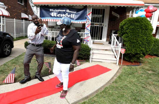 Wendell Brown dances near the red carpet while doing a FaceTime chat with a friend as his mother Antionette Brown is nearby in front of her house in Detroit on Wednesday, September 25, 2019. Brown had been serving three years in a China jail from a bar fight. He was finally released on Tuesday and fly home from China via Los Angeles on Wednesday morning. Brown's mother Antionette was getting ready to host a Thanksgiving dinner for him with other family and friends with his grandmothers cooking that he was looking forward to eating.