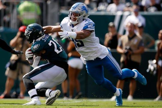 Detroit Lions' Miles Killebrew tackles Philadelphia Eagles' Miles Sanders during the first half Sept. 22, 2019, in Philadelphia.