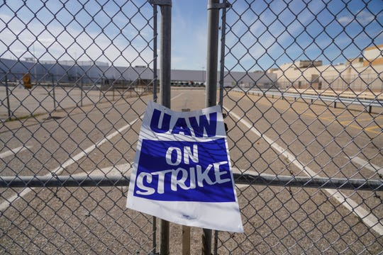 A UAW strike sign sits attached to the south gate near Flint Assembly on Tuesday, September 24, 2019 in Flint as workers continue to be on strike over their contracts with General Motors.