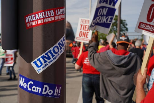 UAW workers on strike against General Motors and other supporters walk the picket line outside of General Motors Detroit-Hamtramck on Wednesday, September 25, 2019 while waiting for Democratic presidential candidate Bernie Sanders to arrive for a brief stop to the auto plant.