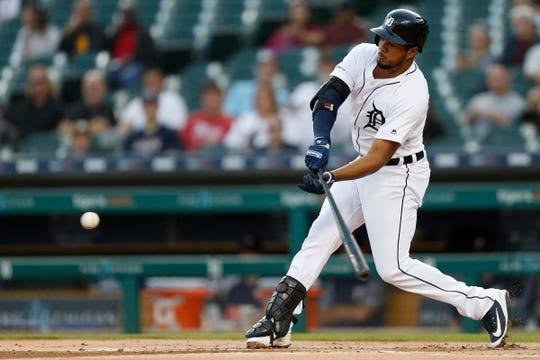 Sep 24, 2019; Detroit, MI, USA; Detroit Tigers first baseman Jeimer Candelario (46) hits a RBI sacrifice fly during the first inning against the Minnesota Twins at Comerica Park on Tuesday, Sept. 24, 2019.
