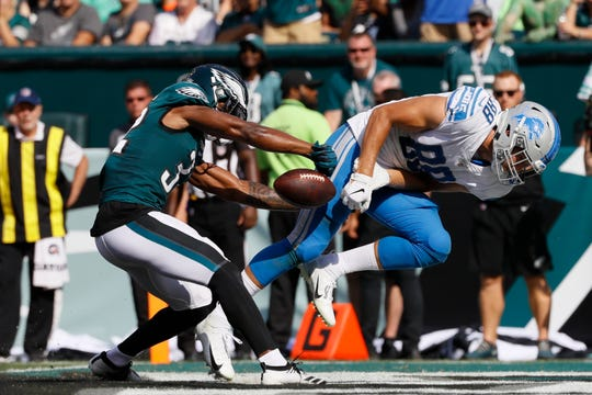 Detroit Lions' T.J. Hockenson has a pass ripped away in the end zone by the Philadelphia Eagles' Rasul Douglas during the second half Sept. 22, 2019, in Philadelphia.