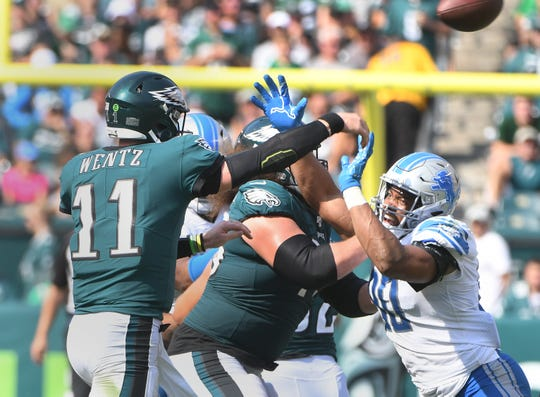 The Lions' Trey Flowers pressures Eagles quarterback Carson Wentz on an incompletion in the third quarter Sunday in Philadelphia.