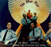 A historic photo of the Detroit Police Department's house band and goodwill ambassadors, the Blue Pigs.