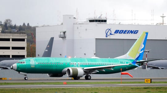 In this April 10, 2019, file photo a Boeing 737 MAX 8 airplane rolls toward takeoff before a test flight at Boeing Field in Seattle. A Chicago law firm says it has settled lawsuits against Boeing on behalf of the families of 11 passengers killed in the crash of a Lion Air jet off the coast of Indonesia.