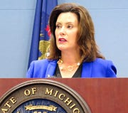 "In this Aug. 28, 2019 file photo, Michigan Gov. Gretchen Whitmer speaks at a news conference in Lansing. Whitmer supports opening an impeachment inquiry, saying in a written statement that Congress should use its ""full investigatory powers"" to find out what happened between Trump and Ukraine."