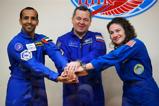 From left, United Arab Emirates astronaut Hazza Al Mansouri, Russian cosmonaut Oleg Skripochka, and U.S. astronaut Jessica Meir, members of the main crew to the International Space Station (ISS), pose during a news conference in Russian leased Baikonur cosmodrome, Kazakhstan, Tuesday, Sept. 24, 2019.