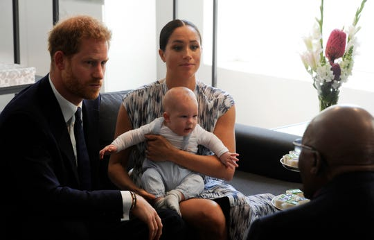 Britain's Prince Harry and Meghan, Duchess of Sussex, holding their son Archie, meet with Anglican Archbishop Emeritus, Desmond Tutu in Cape Town, South Africa, Wednesday Sept. 25, 2019. The royal couple are on the third day of their African tour.