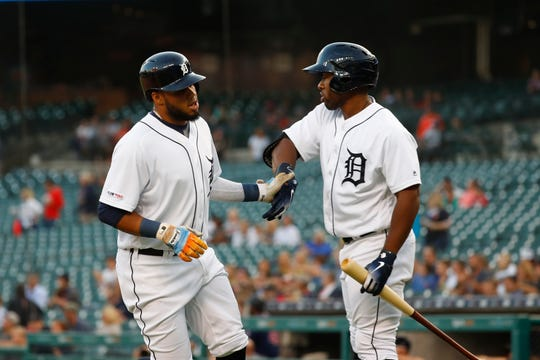 Detroit Tigers' Dawel Lugo, left, celebrates with Christin Stewart after scoring against the Minnesota Twins during the first inning.