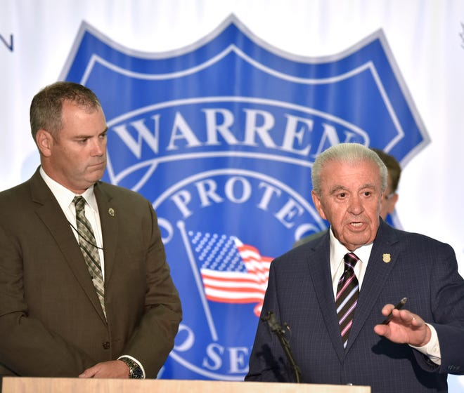 DEA Assistant Special Agent in Charge Kent Kleinschmidt, left, listens as Warren Police Commissioner William Dwyer answers media questions. The pair announced the dismantling of a drug organization after drug raids in Detroit during a press conference at the Warren Police Department Wednesday afternoon, September 25, 2019.