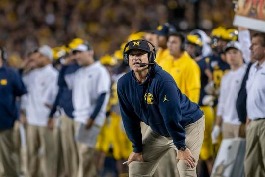 Michigan has posted a 40-15 record under coach Jim Harbaugh, but the Wolverines are only 1-9 against top-10 teams.