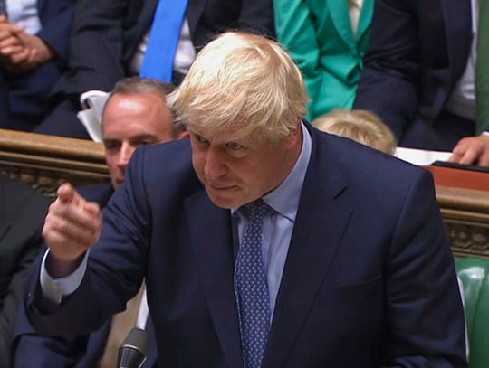 In this handout photo provided by the House of Commons, Britain's Prime Minister Boris Johnson speaks in Parliament in London, Wednesday, Sept. 25, 2019.