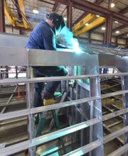 Mike Middaugh, 34, of Onaway welds a stainless steel hull section for the 84-foot Shepler's ferry boat, the William Richard.